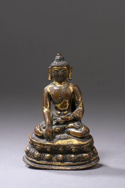 TIBET - XVe siècle Petite statuette de bouddha...