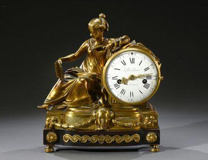Pendule borne en bronze doré et ciselé, figurant...