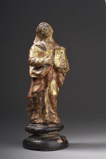 Statuette en terre cuite dorée représentant...