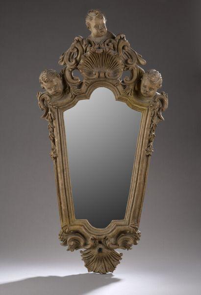 Applique à miroir en terre cuite sculptée...