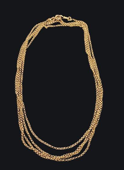 Très longue chaîne de montre en or jaune...