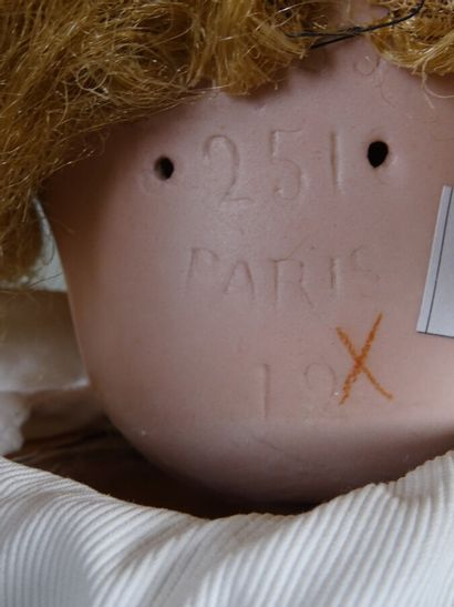 SFBJ 251 Paris Size 12. Bisque head doll, blue glass sleeping eyes, synthetic blond...
