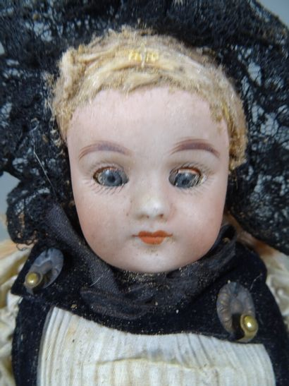 Antique doll with bisque head and bust, remaining wig, blue glass eyes, bisque limbs,...