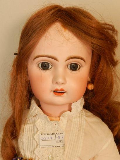 Poupée Jumeau modèle réclame taille 9, tête en biscuit, perruque en cheveux naturels...