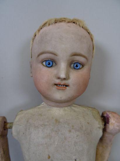 Poupée bébé Steiner gigoteur, tête en biscuit, yeux en verre bleus fixes, bouche...
