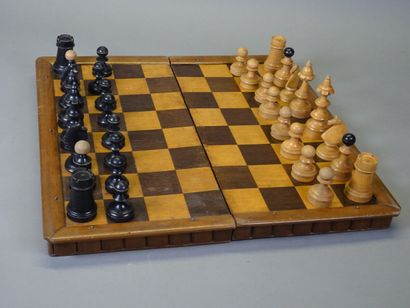 Beautiful old wooden chessboard with 32 turned...
