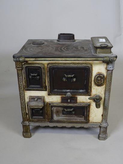 Nice cast iron cooker GODIN, marked G deposited...