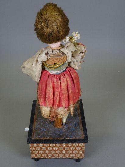 Automate ancien à manivelle « la marchande de fleurs «, poupée tête biscuit allemande...