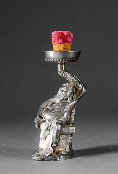 Small bacchus forming a wine decanter in...