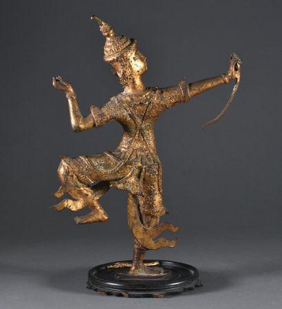 BIRMANIE - Vers 1900  Danseur à l'arc, beau sujet en bronze doré  H. 38 cm  Accident...