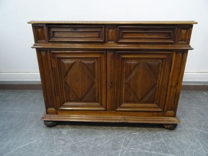 Carved walnut sideboard, opening with two...