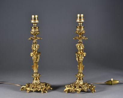 Paire de flambeaux en bronze doré, à décor...