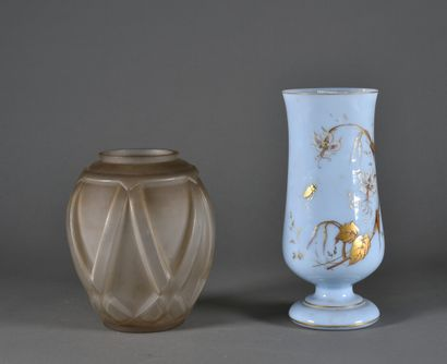 A moulded opaque glass vase with geometric...