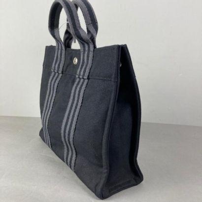 HERMES Paris  Sac mini Toto bag en toile coton noir, double poignée sangle rayée...