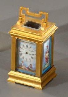 Pendulette cage miniature en laiton doré...