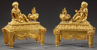 Belle paire de chenets en bronze doré à sujet...
