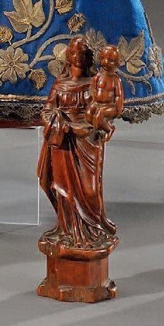 Vierge à l'Enfant en buis foncé, debout sur...
