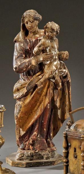 Statuette de Vierge à l'Enfant en bois polychrome...