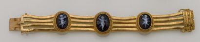 Bracelet en or jaune 18K (750/°°) à quatre...