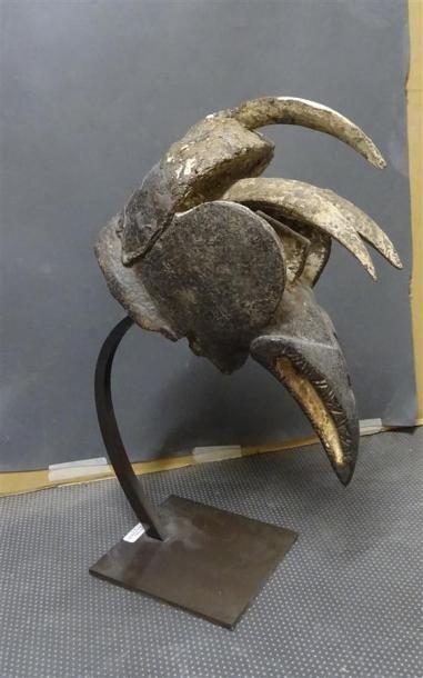 DAN ou GUERE - COTE D'IVOIRE Elément décoratif en bois sculpté simulant une tête...