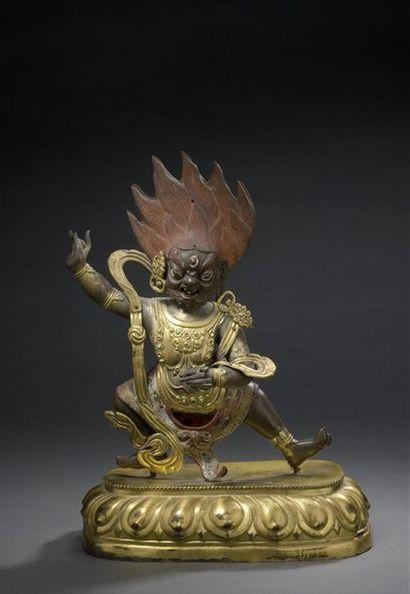 TIBET - XIXe siècle Statuette en cuivre et bronze doré et polychrome, Mahakala courroucé,...