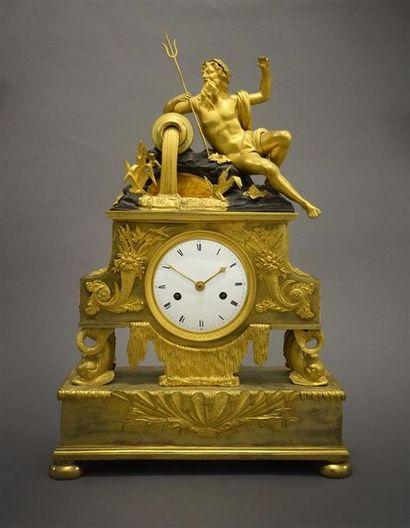 Pendule en bronze doré dite «au bassin de...