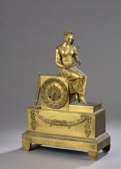 ? Pendule en bronze doré ornée d'une allégorie...