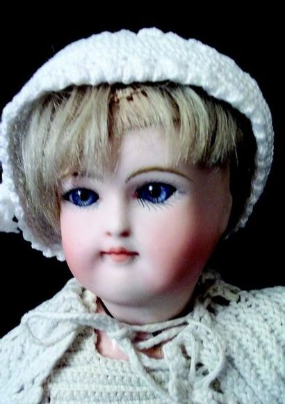Delightful little German baby from KESTNER, Dome head in biscuit with closed mouth,...