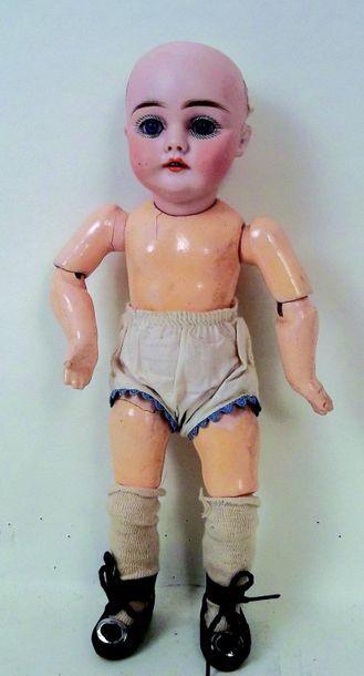 Petite poupée de fabrication allemande, tête...