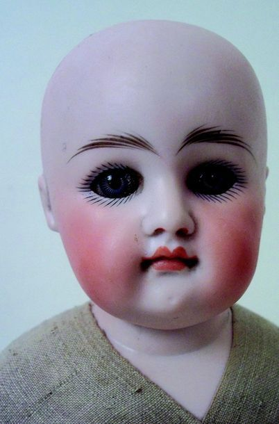 German doll with bust head in cast biscuit, closed mouth, wounded sleeping eyes...