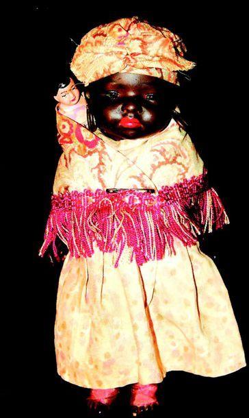 Bébé caractère noire avec enfant, tête pleine...