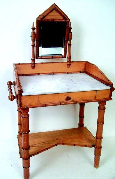 A dressing table with marble top and a psyche...