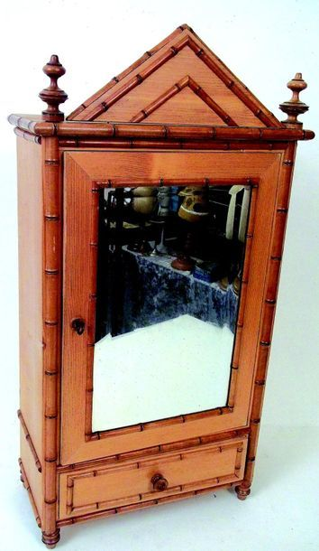 Cupboard with a glass door and a drawer at...
