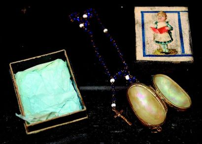 Miniature mother-of-pearl egg containing...
