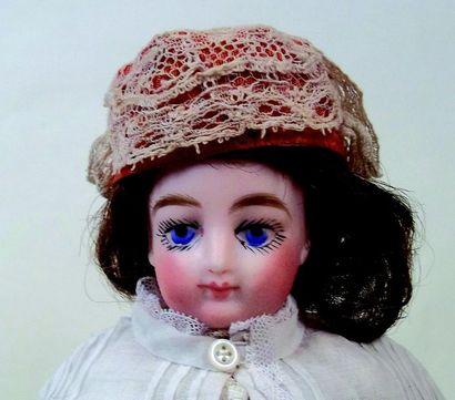 -Petite poupée parisienne avec corps ployant...