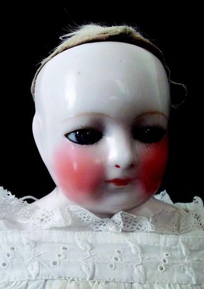 Rare Parisian doll from the house BLAMPOIX, porcelain bust head with closed mouth...
