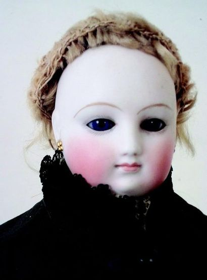 -Parisian doll with bust head in pressed biscuit from the house François GAULTIER...