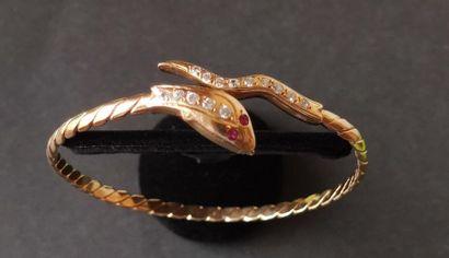 Bracelet en or 18K (750), les extrémités formant la tête et la queue d'un serpent,...