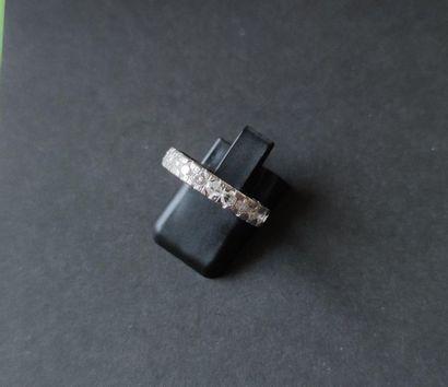 Platinum wedding band, entirely set with round brilliant diamonds. Finger size:...