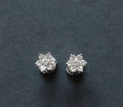 """Pair of 750°/°° white gold """"flower"""" earrings BUTTONS each set with seven small cut..."""