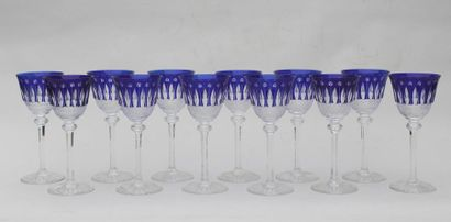SAINT LOUIS SUITE of 12 Rhine wine glasses in cut and blue tinted crystal on a translucent...