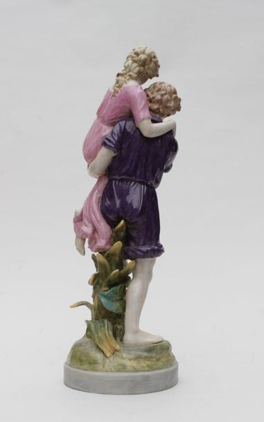 GROUP in polychrome enamelled porcelain representing a couple dressed in the antique...