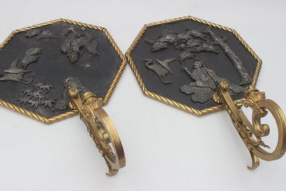 Pair of gilt bronze sconces with metal plates...