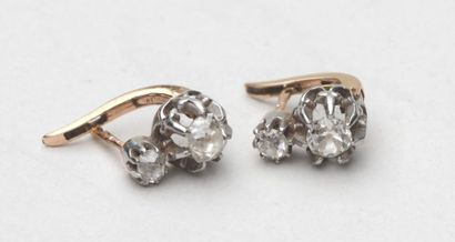 Pair of 750°/00 yellow gold earrings, each set with two cut diamonds, Gross weight:...