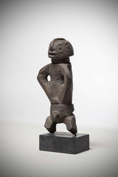 KAKA (Cameroon/Nigeria)  Male STATUS with a crusty black patina; the short legs...