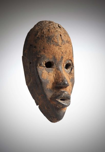 DAN (Ivory Coast)  Running MASK with round eyes and a patina of cola nut powder....