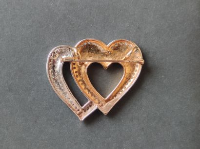 """Double """"hearts"""" brooch in yellow and white gold 750°/°°° set with entourages of..."""