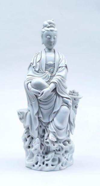 STATUTE in white porcelain representing...