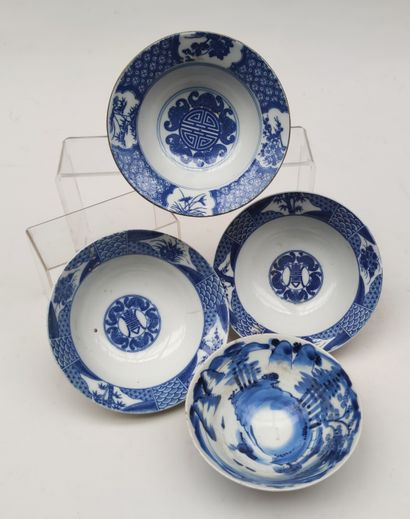 Set of four porcelain bowls with monochrome...
