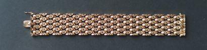 BRACELET flexible ribbon in 750°/°° yellow gold Length : 19.5 cm Weight : 57 gr....